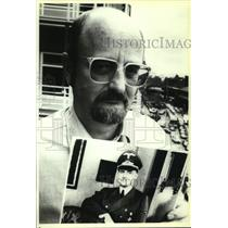1991 Press Photo Niklas Frank holds photo of father, Hans Frank of Nazi-Polland.