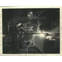 1937 Press Photo White Hot Liquid Will Become Steel As Workman Pour Into Molds