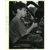 1992 Press Photo Brian Givens sits at the controls of a U.S. Customs helicopter