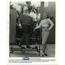 1998 Press Photo Santa Claus and Kathy Kaehler try new Nordic Track equipment