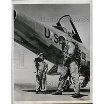 1956 Press Photo Little Wesley Smith shows his coverall to his Test Pilot father