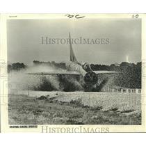 1968 Press Photo Lightning fighter plane lands on gravel runway in England