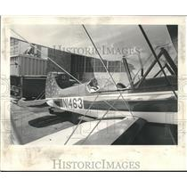 """1969 Press Photo Sims proudly maneuvers his completed """"Starduster, Too"""" plane"""