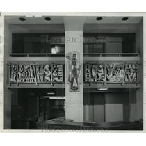 1955 Press Photo Memorial Library of Marquette University gets two wood murals.