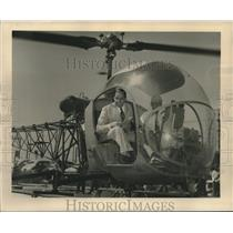 1950 Press Photo Executives on board a helicopter for a test flight - nob34395