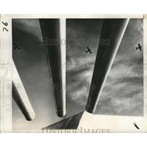 1945 Press Photo Warplane silhouettes between 16-inch guns brackets of warship