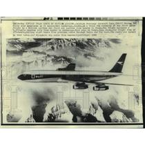 1969 Press Photo A Boeing 707 flies over mountains as it nears Anchorage, Alaska