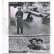 1962 Press Photo Vietcong guerrillas under guard in camp near Ban Me Thout