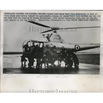 1952 Press Photo Royal Navy Crew helps Helicopter from Heavy Winds