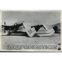 1950 Press Photo C-119 cargo plane with tails bent down after Japan flight