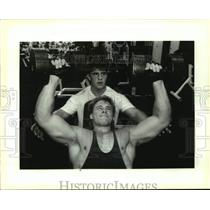 1993 Press Photo Butch Jeansonne spots Greg Nichols during dumbbell bench press