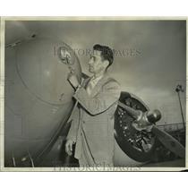 1954 Press Photo Gene Baker Mounts Glide Slope Antenna in Nose of Ship