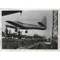 1952 Press Photo F-84 Thunder Jet is Unloaded in Copenhagen from U.S. Carrier