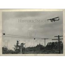1970 Press Photo Small plane flies over the Schenectady New York County Airport.