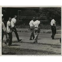 1957 Press Photo Group Walking Across Street, Bessemer, Alabama - abno09973