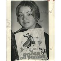 1973 Press Photo Patti Johnson holding a book on '73 Disney On Parade