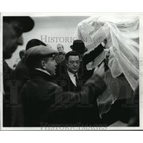 1968 Press Photo Men look under plastic tarps inside Houston Int. Airport