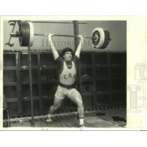 Press Photo Sean Duncan lifts 302 pounds on barbells above his head for C.B.A.