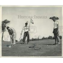 1954 Press Photo animators drew fun things on these Milwaukee golfers