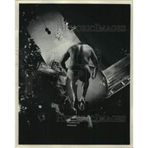 1965 Press Photo Diver Al Gonzales plunges to tank down 110 feet at Sports Show