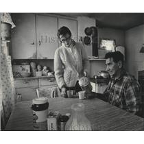 1970 Press Photo Menominees Mrs. and Henry Tomow in kitchen, Wisconsin