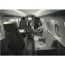 1972 Press Allen K. Pepin, Vice President of Sales, relaxing in cabin of BH-125