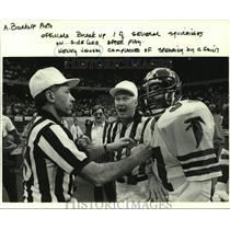 1985 Press Photo Atlanta Falcons football player Kenny Johnson and NFL officials