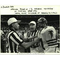 1985 Press Photo Atlanta Falcons football player Kenny Johnson and NFL officials