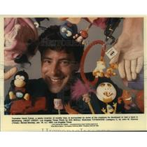 1993 Press Photo Toymaker David Fuhrer surrounded by toys he developed