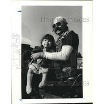 1986 Press Photo Allen Moorhead of Wheels for Jesus gang holds Ashley Gonzales