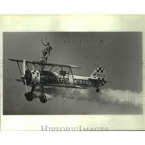 1984 Press Photo World Aerobatic Team - Paula Cherry on top of airplane
