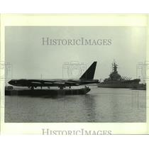 1985 Press Photo B-52 Bomber airplane being transported on a boat, Alabama