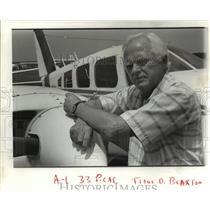 1987 Press Photo Aircraft Sales Company Owner Titus O. Blaxton Next To Plane