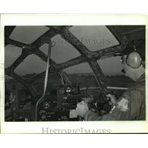 1989 Press Photo Pilot in the cockpit of a B-29 airplane, Alabama - amra03691