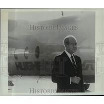 Press Photo Robert A Maheu stands before a Hughes-owned plane. - tua36942