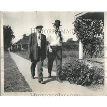 1931 Press Photo Depression Era Men Lucas And Adams Stroll Down Sidewalk