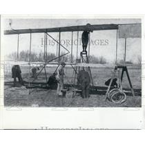 Press Photo Workers Inspect Early Plane after Crash - XXB11369