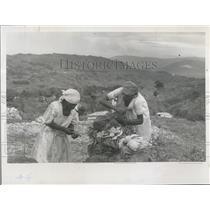 Press Photo Haitian Women Smoking Homemade Mahogany Pipes - XXB05193