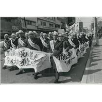 1974 Press Photo Japanese dairy farmers stage a protest march