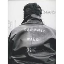 Press Photo Motorcycle Rider Wearing Jacket Saying Laramie Wild One No Helmet