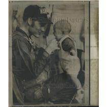Press Photo Lt. Lewis Folzer and son Lenny after flying into Norfolk - RSH43737
