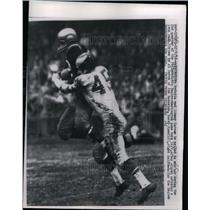 1956 Press Photo Eagles Rocky Ryan Tackles Redskin End Johnny Carson