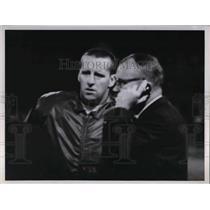 1964 Press Photo Football Coach talks on phone on field - nea15979