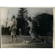 1928 Press Photo Univ. of Calif. runner hit third base against Ambrose Tailors.