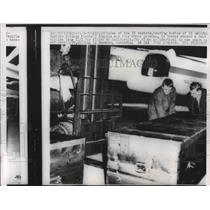 1960 Press Photo 19 Casket of Calif. Tech College players loaded aboard a C-16.