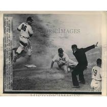 1949 Press Photo Danny Murtaugh of Pirates slides safe over first base.