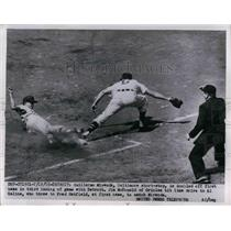 1955 Press Photo Baltimore's Guillermo Miranda doubled off 1st in Detroit game