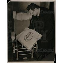 1939 Press Photo Reporter Looking at Built In Life belt Used in Case of Danger