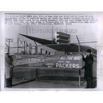 1960 Press Photo Joseph Grishaber, Carl Stumpf, Holding Green Bay Packer Sign