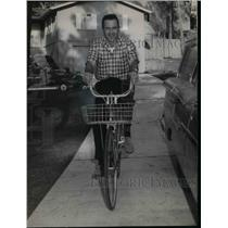 1965 Press Photo Lt Frank King Ellis riding his bicycle - nea34627